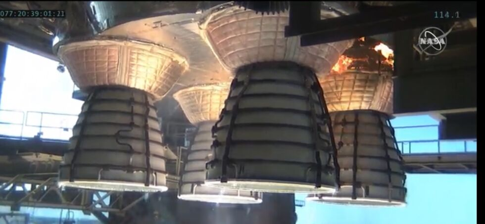 Cork insulation around one of the rocket's four main engines catches fire.