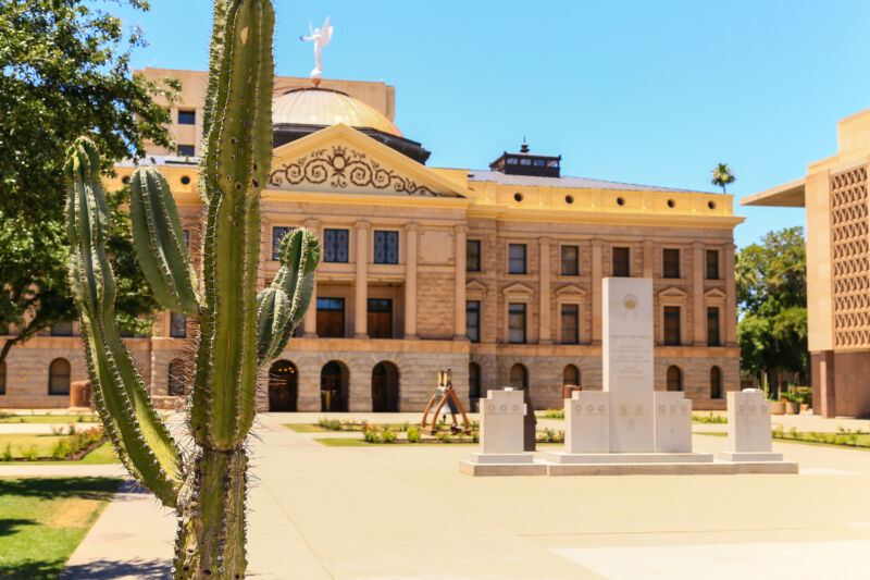 The Arizona State Capitol museum, flanked by the House of Representatives building (R) and a cactus (L).