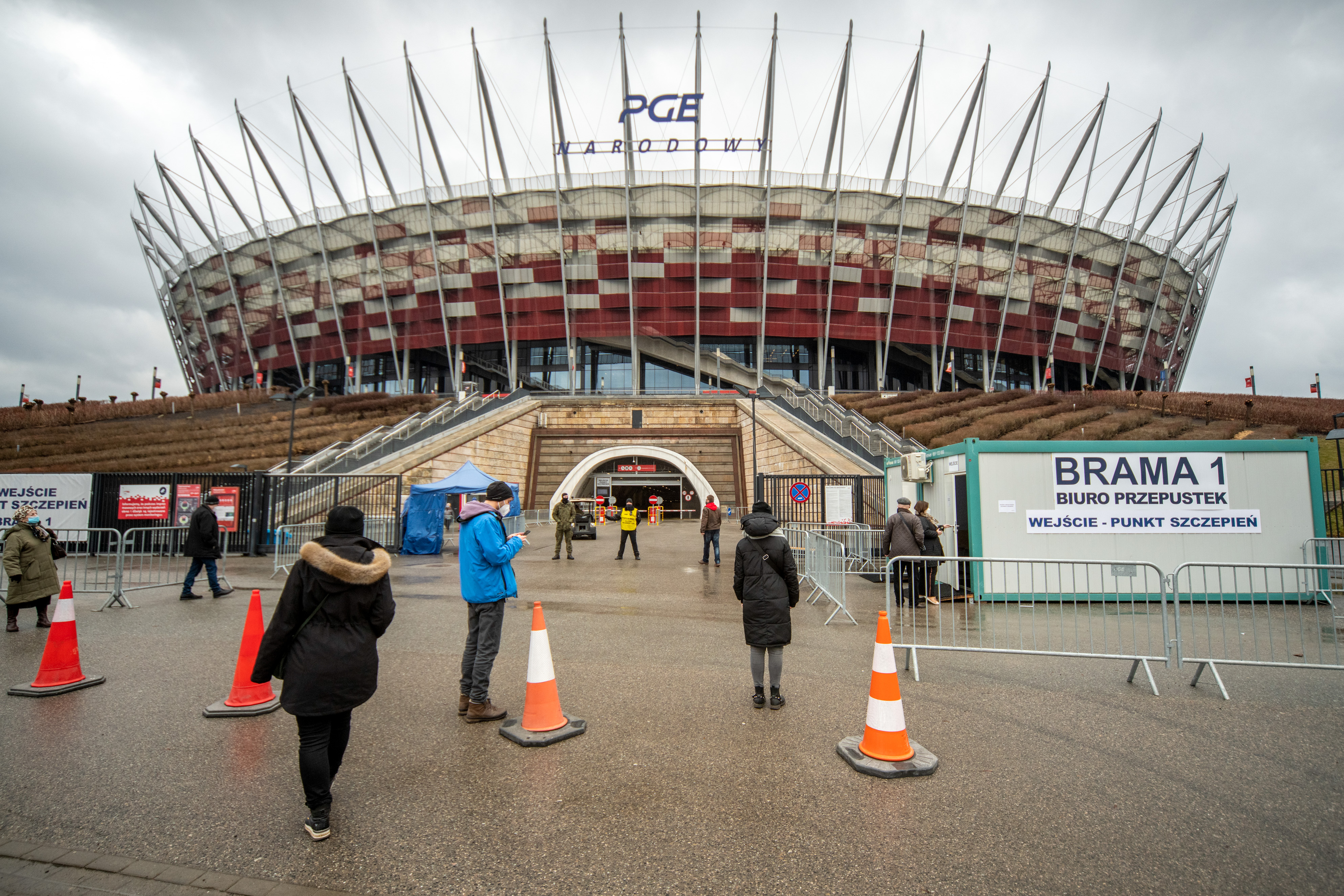 Visitors at an entrance to a COVID-19 vaccination center in Poland's National Stadium in Warszawa, Poland.