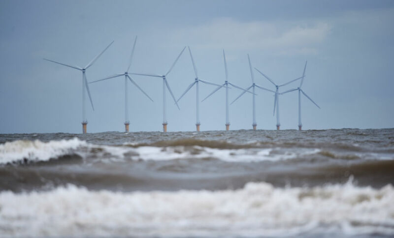 Moderate seas surround an offshore wind farm.