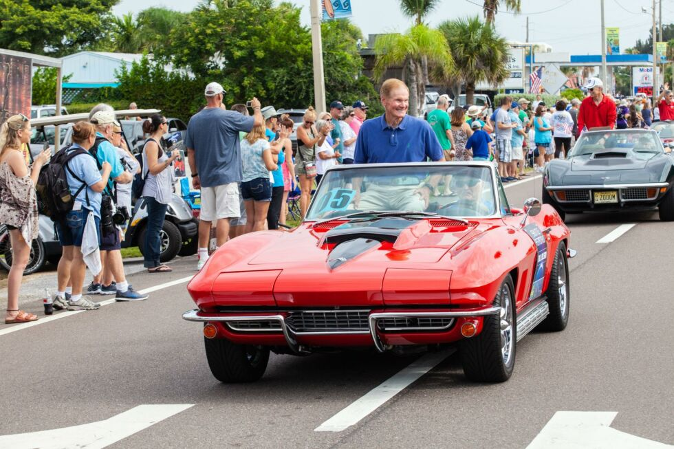 One-time shuttle astronaut and former US Senator Bill Nelson rides in a classic Corvette during the
