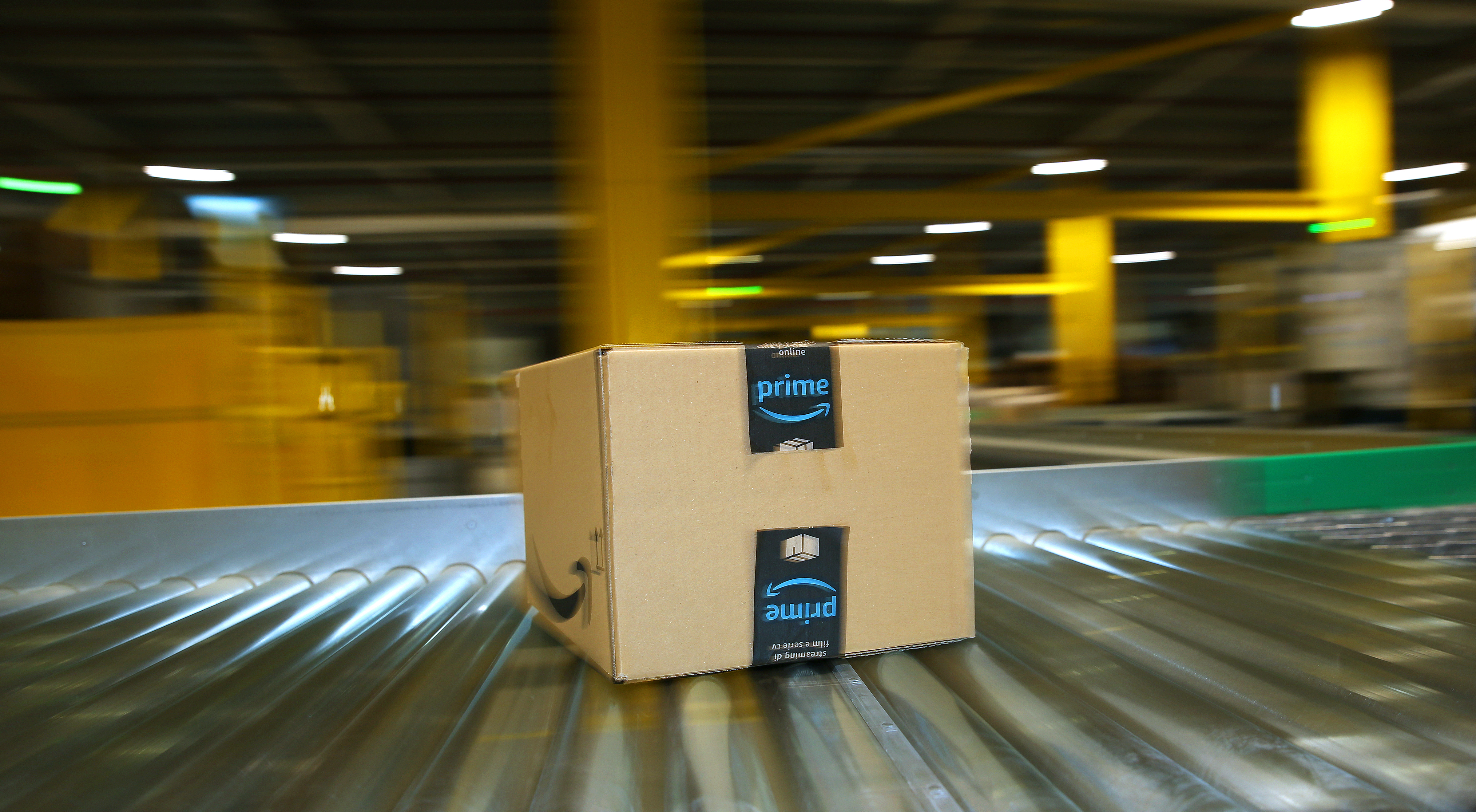 A package is transported on a conveyor belt in an Amazon logistics center.
