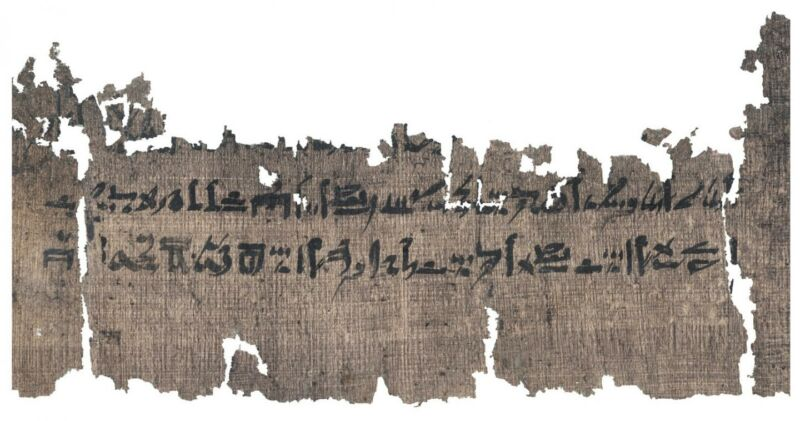 Battered ancient text against a white background.