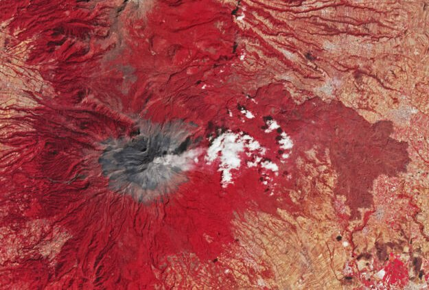 Popocatépetl, a volcano near Mexico City, steams away in this false-color satellite image (making vegetation appear red).
