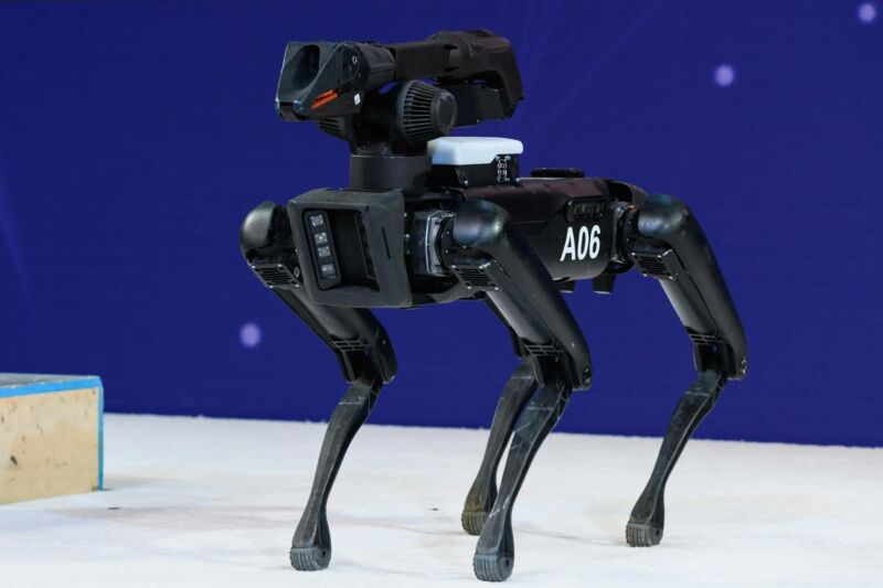 A black robot that is in the abstract shape of a dog.