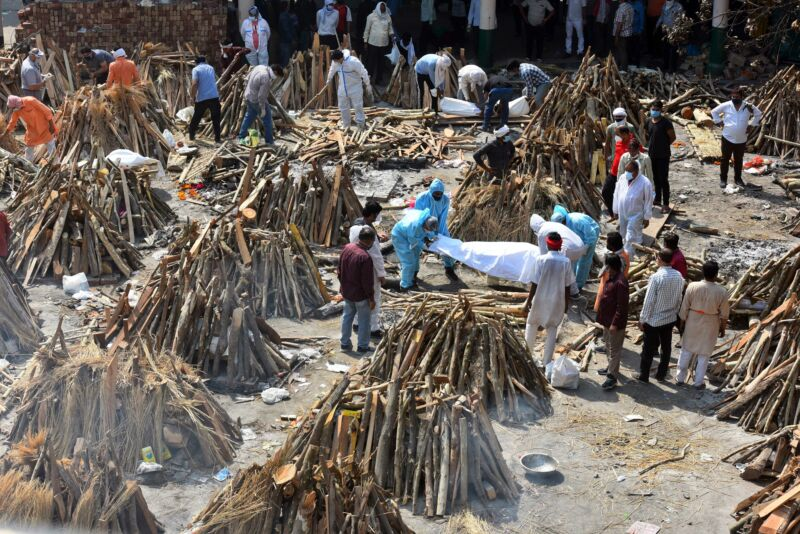 Funeral pyres of people who died of COVID-19 being prepared simultaneously at Gazipur crematorium on April 26, 2021 in New Delhi, India.