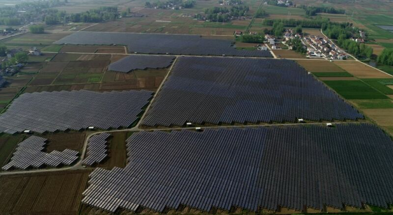 Aerial photograph of solar farms mixed with traditional farmland.