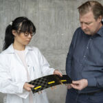 Doctor Johanna Xu with a newly manufactured structural battery cell in Chalmers' composite lab, which she shows to professor Leif Asp.