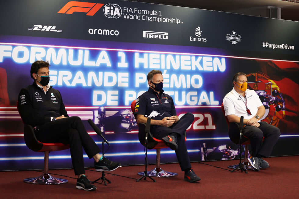 Mercedes GP Executive Director Toto Wolff (L), Red Bull Racing Team Principal Christian Horner (M), and McLaren Chief Executive Officer Zak Brown (R) talk in the Team Principals Press Conference during practice ahead of the F1 Grand Prix of Portugal at Autodromo Internacional Do Algarve on April 30, 2021, in Portimao, Portugal.