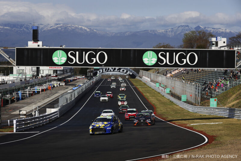 A grid of racing cars at a track in Japan