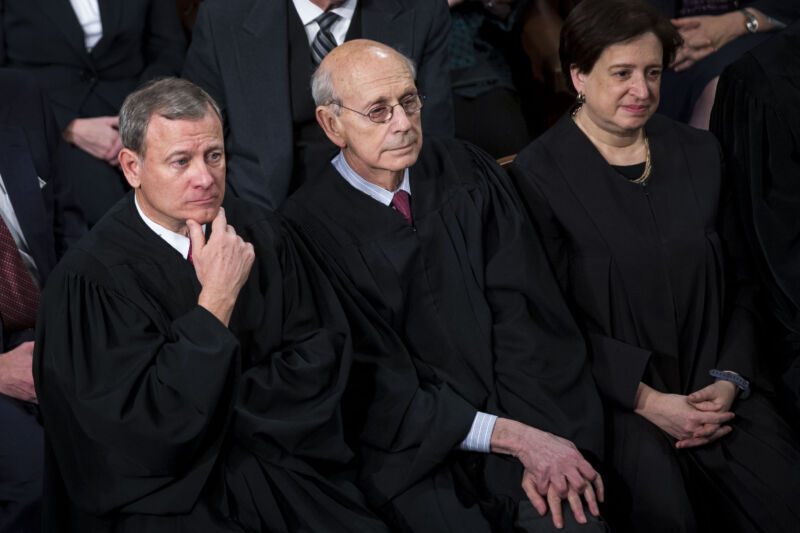 Supreme Court Justices John Roberts, Stephen Breyer, and Elena Kagan sitting and listening to a State of the Union address in Congress.