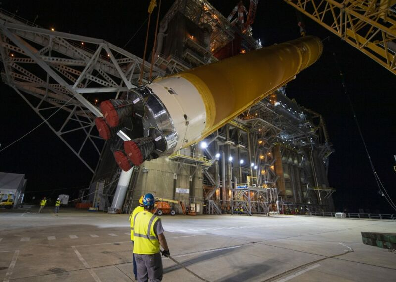 NASA and Boeing work to remove the SLS rocket core stage from its test stand in Mississippi.