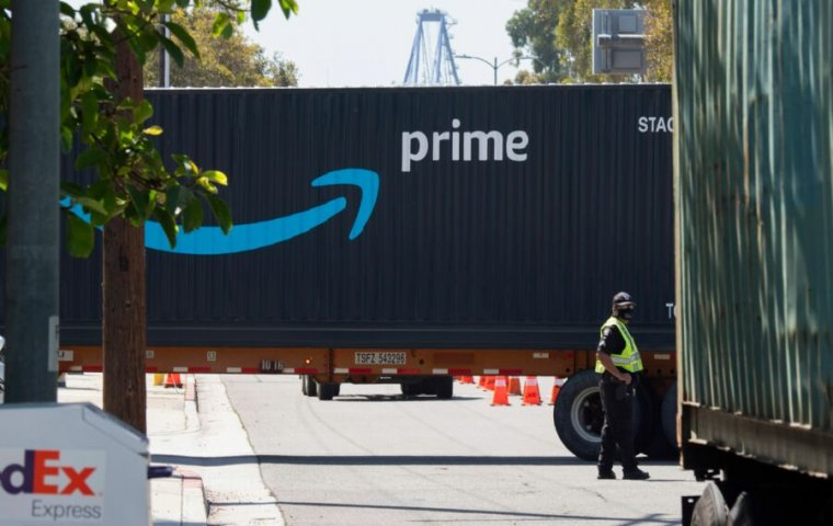 An Amazon Prime delivery truck drives through the Port of Los Angeles and Long Beach on April 22, 2020, in Long Beach, California. (Photo by Robyn Beck / AFP)
