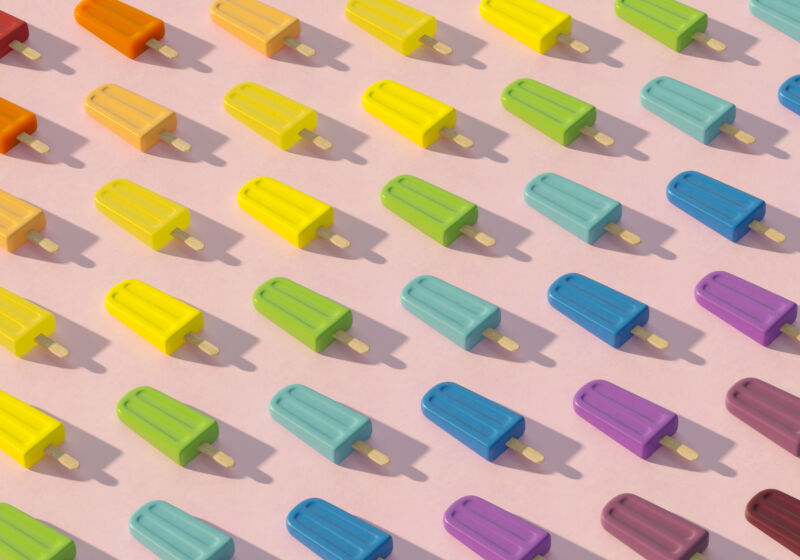 """""""Digital generated image of popsicles organized into rainbow colored pattern on pink surface,"""" thanks Getty Images."""