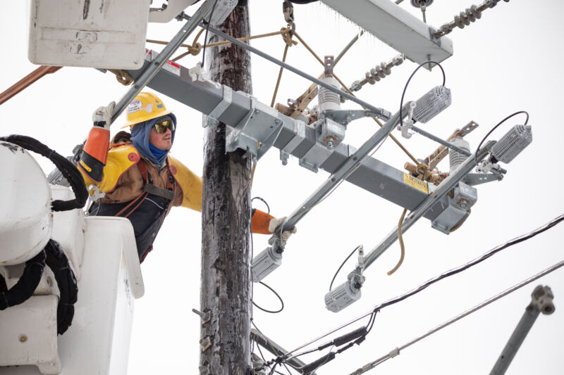 A worker repairs a power line in Austin, Texas, on Thursday, Feb. 18, 2021.