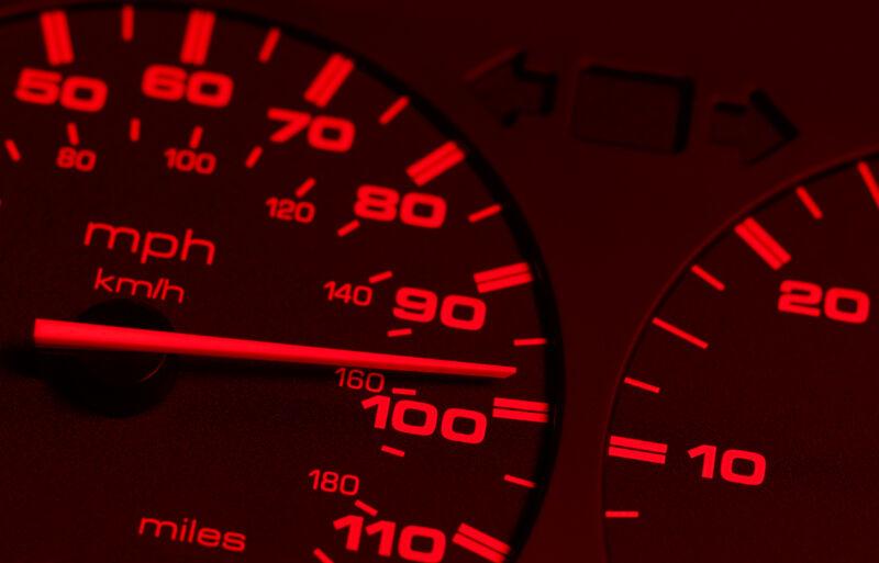 Stock photo of extreme close-up of redline speedometer.