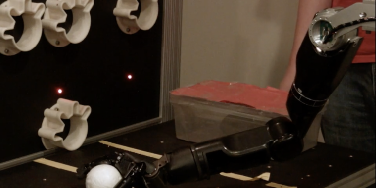 Brain implant gives robotic arm a sense of touch