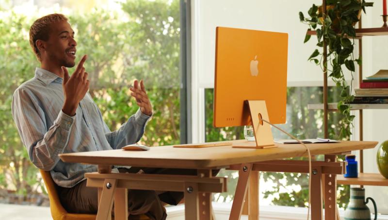 A man works on an iMac