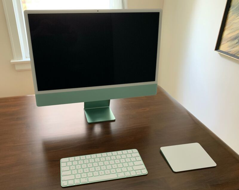 An iMac with a keyboard and trackpad
