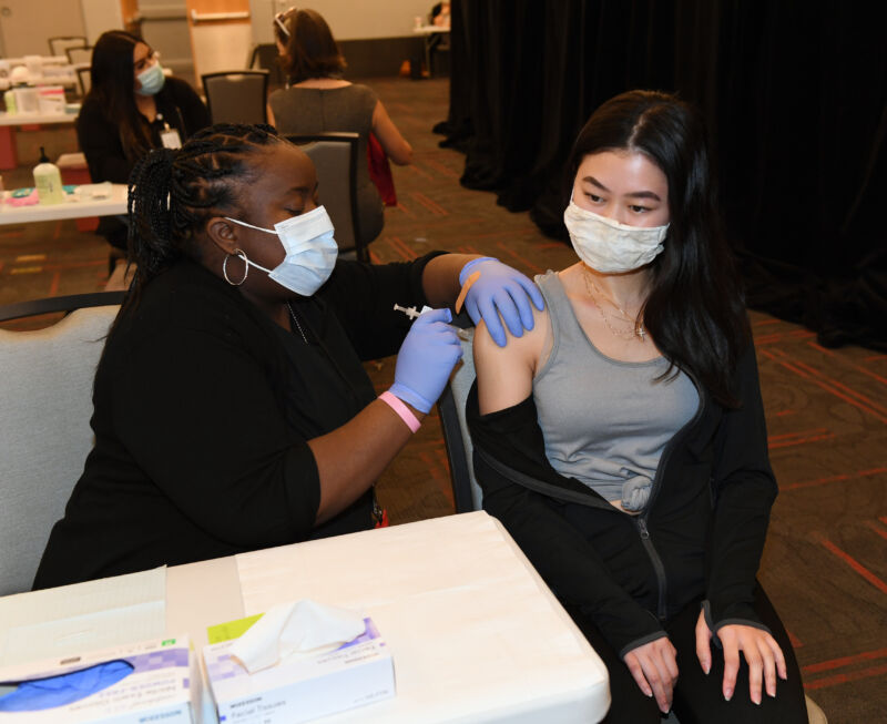 A UNLV Medicine medical assistant administers a Pfizer-BioNTech COVID-19 vaccination to a UNLV School of Nursing student.