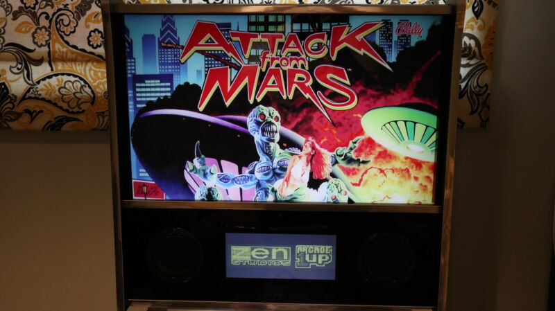 Say hello to the Arcade1Up Attack From Mars physical pinball cabinet. The chassis is physical; its games are all virtual. Read below to understand what the heck that means.