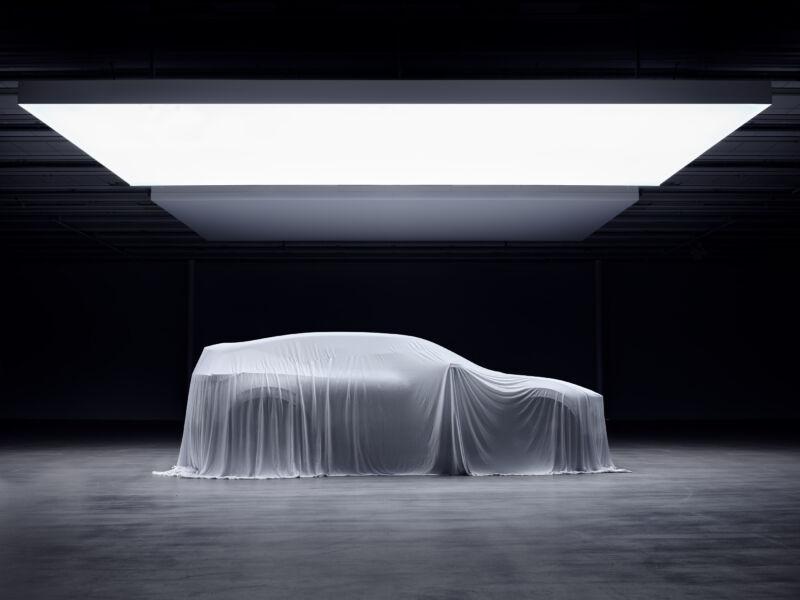 An SUV underneath a white sheet