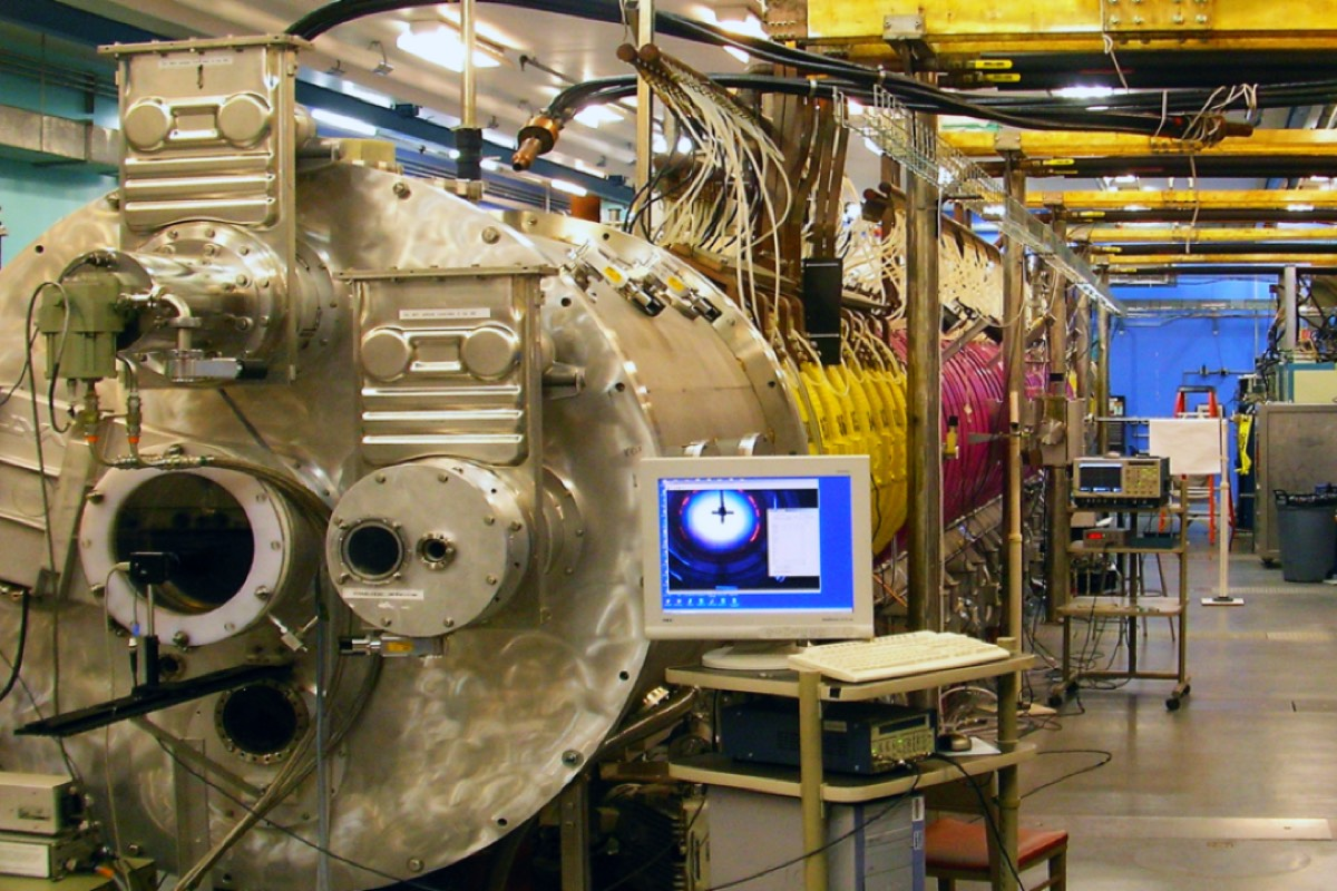 Panoramic view of the Large Plasma Device, a nearly 20-meter-long, 1-meter diameter cylindrical vacuum chamber wrapped in powerful axial magnetic field coils (purple and yellow).