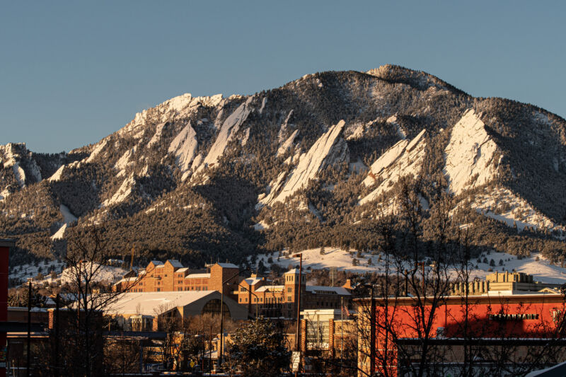 Morning sun against the foothills of Boulder, Colorado, business area and campus.