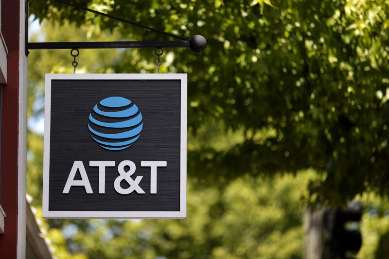 An AT&T sign in front of a retail store