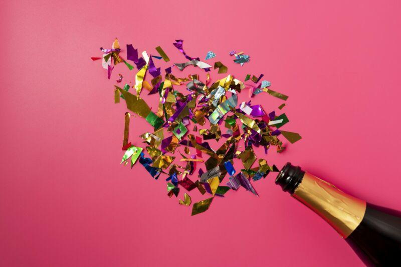 Champagne bottle and confetti