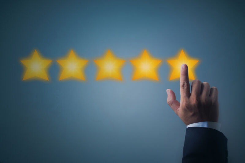 Illustration of five stars and a person's hand to represent a five-star online review.