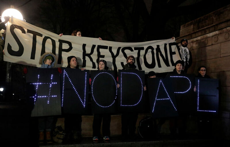 Opponents of the Keystone XL and Dakota Access pipelines hold a rally as they protest US President Donald Trump's executive orders advancing their construction, at Columbus Circle in New York on January 24, 2017.