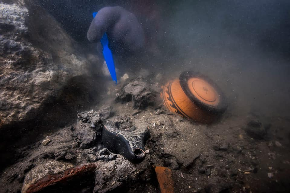 Divers examined the wreck after a sonar survey rediscovered it buried in mud and debris.