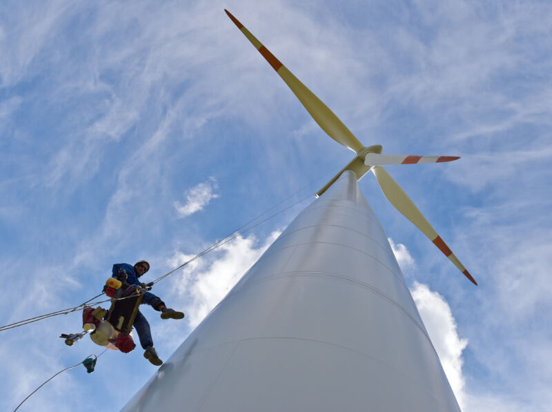Industrial climber Torsten Kuehne repairs a wind turbine about 60 meters high in Wulkow, Germany.