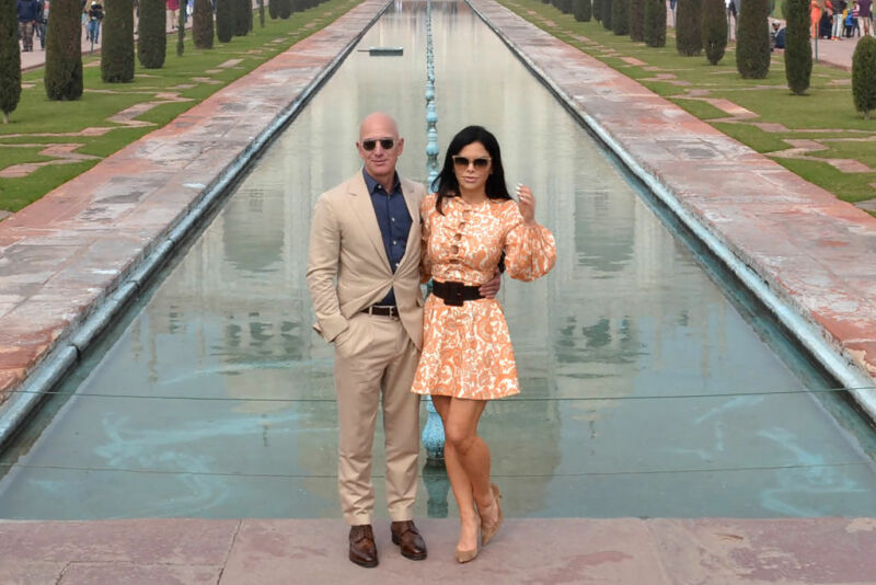 Jeff Bezos and his girlfriend Lauren Sanchez pose for a picture during their visit at the Taj Mahal in January 2020.