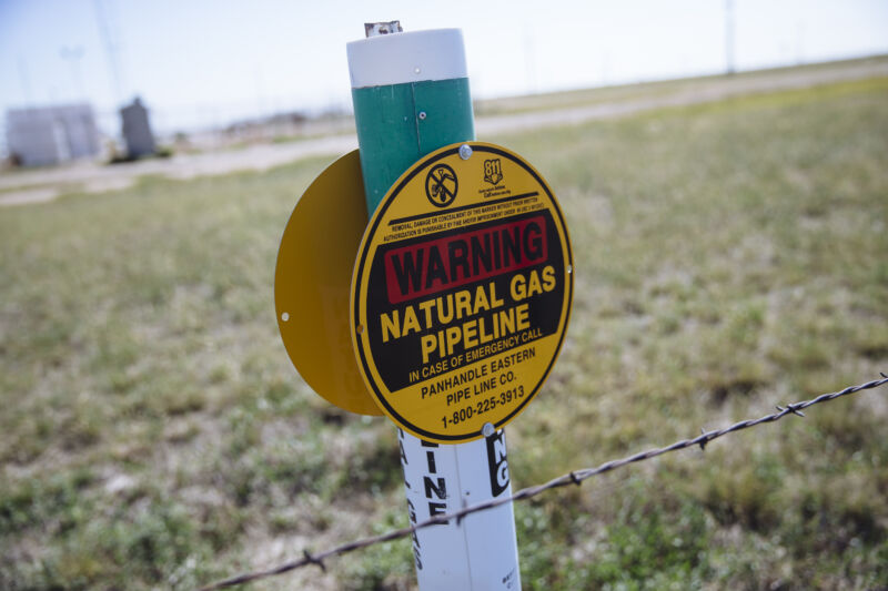 A warning sign for an underground natural gas pipeline stands near Sunray, Texas.