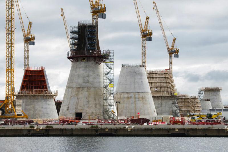 Image of massive concrete cones and cranes.