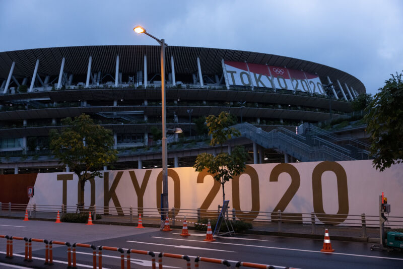 Exterior of a sports arena at dawn or dusk.