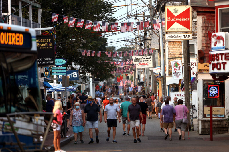 Foot traffic along Commercial Street in Provincetown, Mass., on July 20, 2021. Provincetown officials have issued a new mask-wearing advisory for indoors, regardless of vaccination status, on the latest data showing that Provincetown COVID cases are increasing.