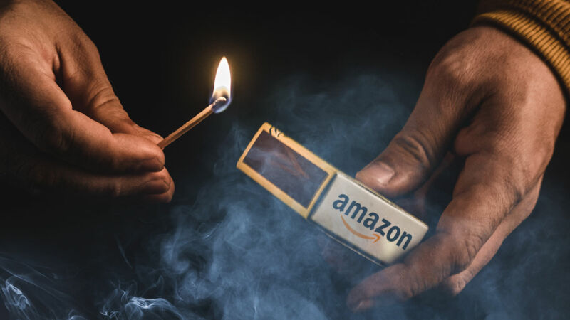 Illustration of smoke, a lit match in a person's hand, and a matchbox with an Amazon logo.