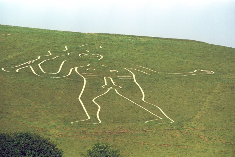 """Behold, the """"Rude Man"""" chalk giant carved on a hill above the village of Cerne Abbas in Dorset, England."""
