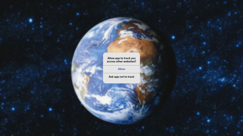 A user interface warning pops up over an image of the Earth from space.