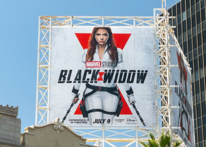 A billboard promoting the movie Black Widow with a giant picture of Scarlett Johansson.