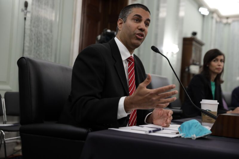 Then-FCC Chairman Ajit Pai and Commissioner Jessica Rosenworcel sit at a table while testifying at a Senate hearing.