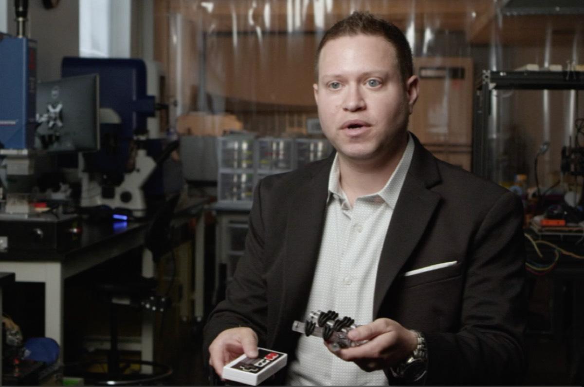 University of Maryland mechanical engineer Ryan D. Sochol shows off his team's soft robotic hand.