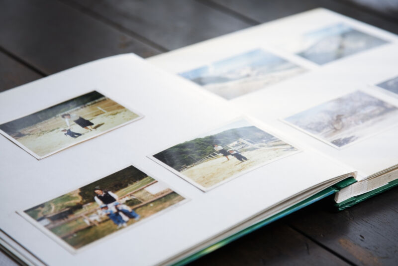 Stock photo of photo album open on a table.