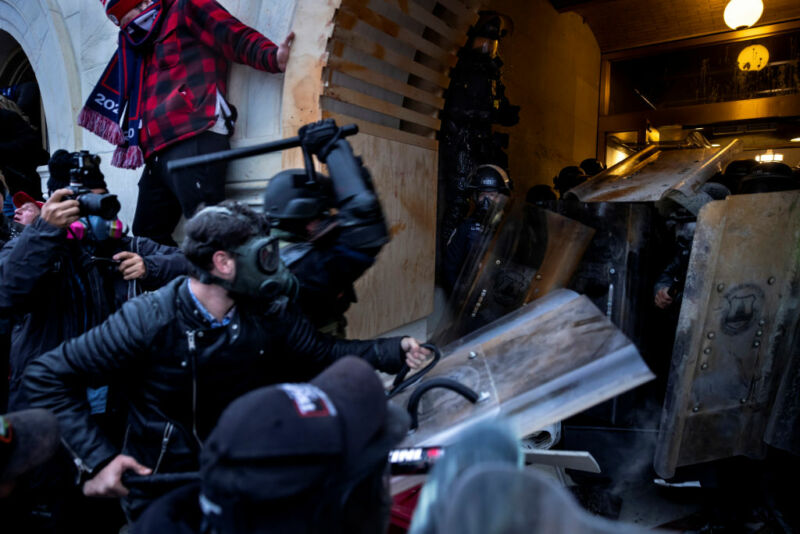 Images of rioters attacking police at the US Capitol.
