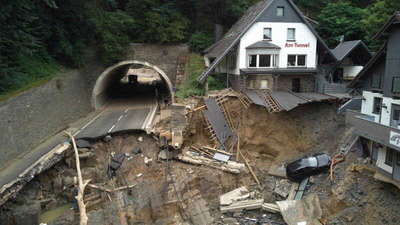 Image of a destroyed road and parking area.