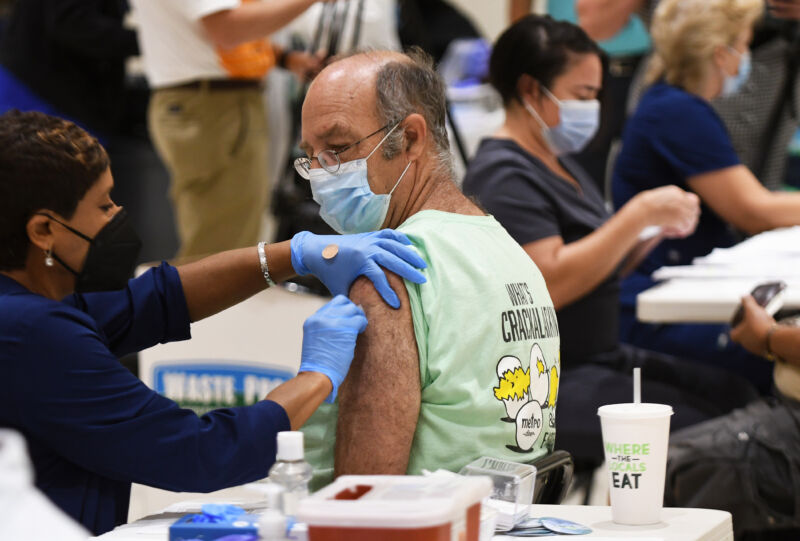 A nurse administers a COVID-19 shot at a vaccination site in Florida on August 18, 2021.