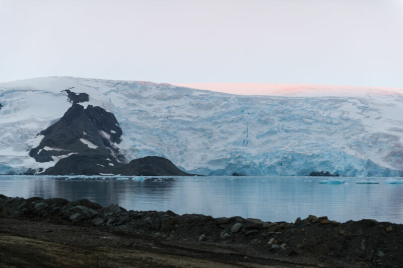 Image of glaciers terminating above water.